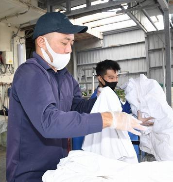洗濯技術は世界レベル 沖縄イリョーサービスが国際規格を取得