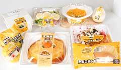 沖縄ファミリーマートは10日から、サンリオがデザインした卵のゆるキャラ「ぐでたま」と協業したおむすびや弁当、スイーツなど計9商品=写真=を県内限定で販売して